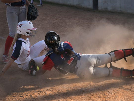 A North DeSoto player slides into home against Ellender Friday afternoon in the LHSAA Class 4A state playoffs.