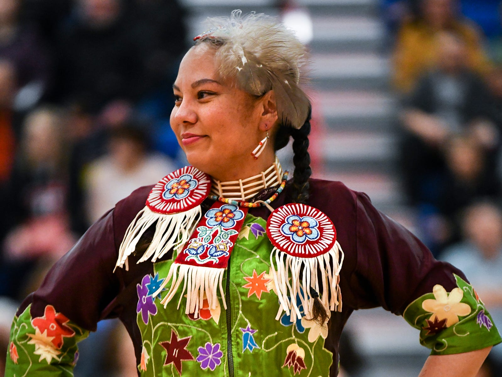 Tara Novak smiles while dancing during the 25th annual American Indian Center Powwow Saturday, April 13, at Apollo High School in St. Cloud.
