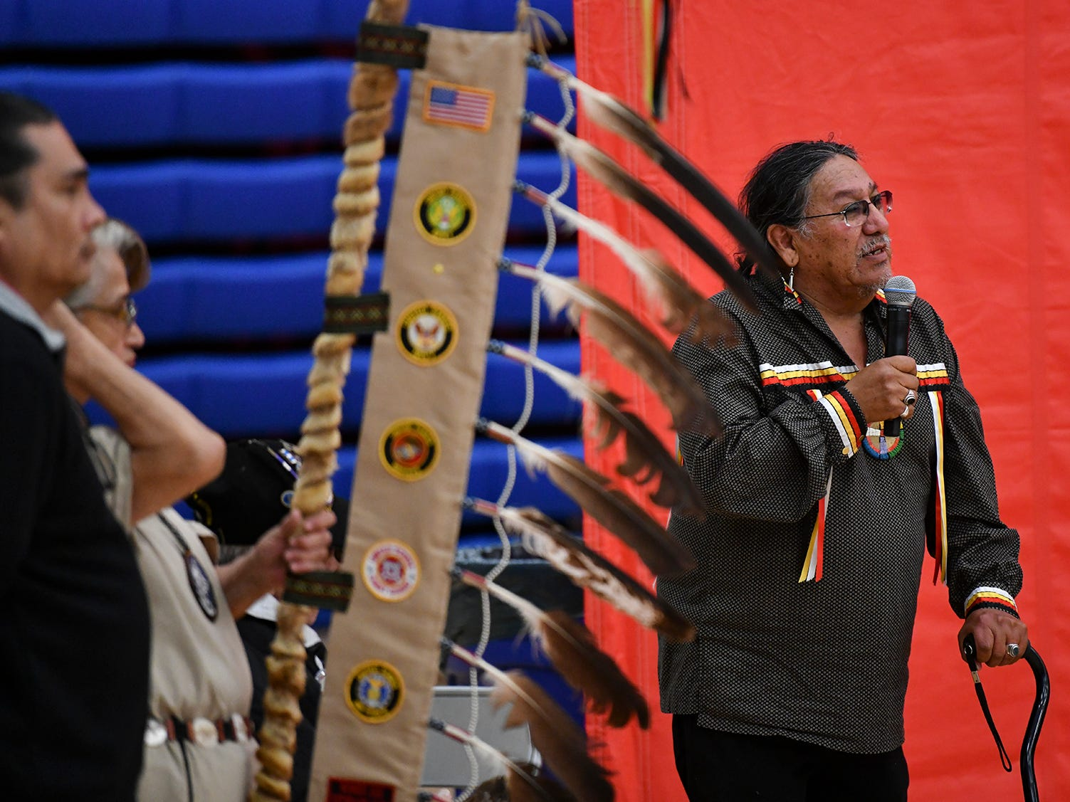 Spiritual advisor Joe Whitehawk speaks before the start of the 25th annual American Indian Center Powwow Saturday, April 13, at Apollo High School in St. Cloud.