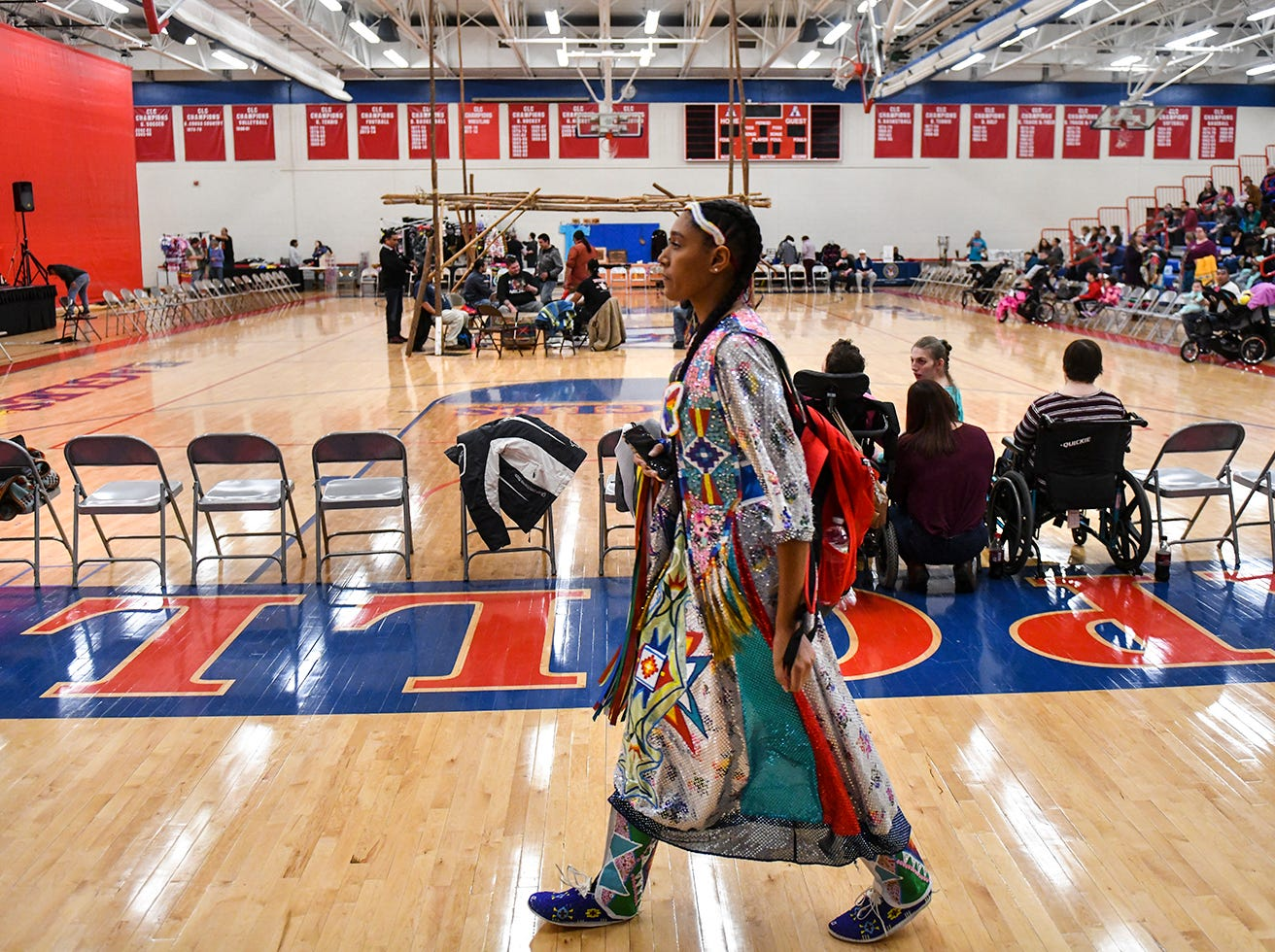People gather for the the 25th annual American Indian Center Powwow Saturday, April 13, at Apollo High School in St. Cloud.