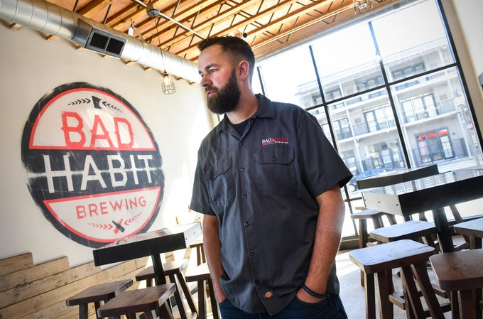 Owner Aaron Rieland talks about features of the space at the new Bad Habit Brewing Company location Saturday, April 13, in St. Joseph. The renovated building was the former location of St. Joseph City Hall.