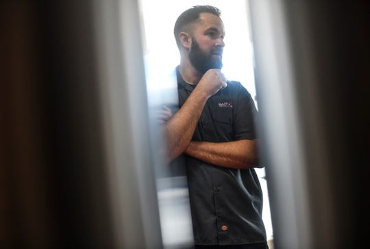 Aaron Rieland talks about new brewing equipment installed at the new Bad Habit Brewing Company location Saturday, April 13, in St. Joseph.