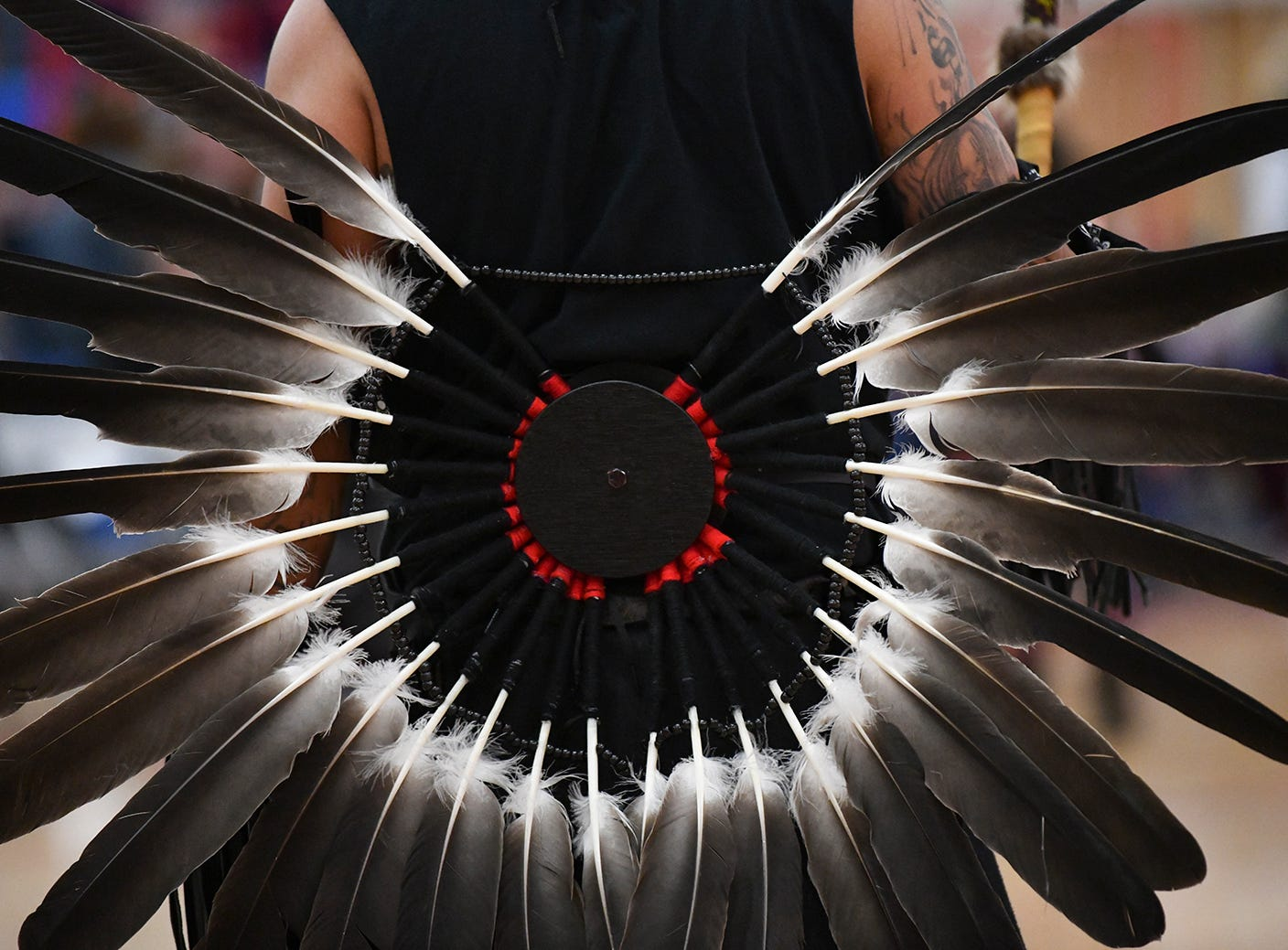 Feathers adorn a dancer during the 25th annual American Indian Center Powwow Saturday, April 13, at Apollo High School in St. Cloud.