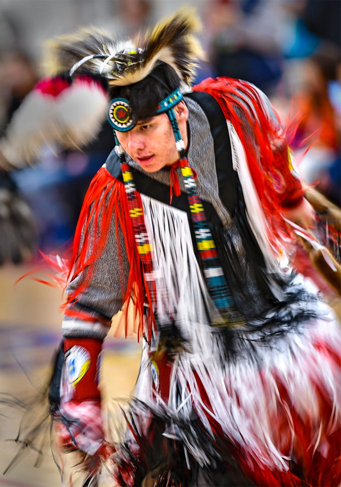 Head male dancer Chris Charging Eagle dances in full regalia during the 25th annual American Indian Center Powwow Saturday, April 13, at Apollo High School in St. Cloud. Saturday's powwow featured two grand entries, a hand drum contest, food and vendors. For more photos go to www.sctimes.com.
