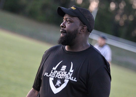 Lincoln flag football coach Brandon Youmans watches his team as Lincoln upset No. 6 Florida High 12-7 on Thursday, April 11, 2019 to clinch a district playoff spot.