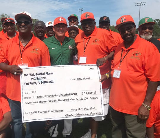 Charles Johnson, Sr., FAMU baseball coach Jamey Shouppe, Tony Bell and Ephraim Riggins display the check of the funds raised for FAMU baseball. The baseball alumni gathered for their seventh annual reunion weekend April 12-15, 2019.