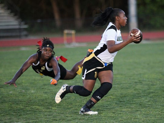 Lincoln quarterback Erin Turral escapes diving Florida High defender Janae Scott as Lincoln upset No. 6 Florida High 12-7 on Thursday, April 11, 2019 to clinch a district playoff spot.