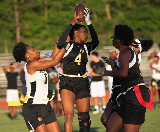 Florida High junior Jada Rhodes high points an interception as Lincoln upset No. 6 Florida High 12-7 on Thursday, April 11, 2019 to clinch a district playoff spot.