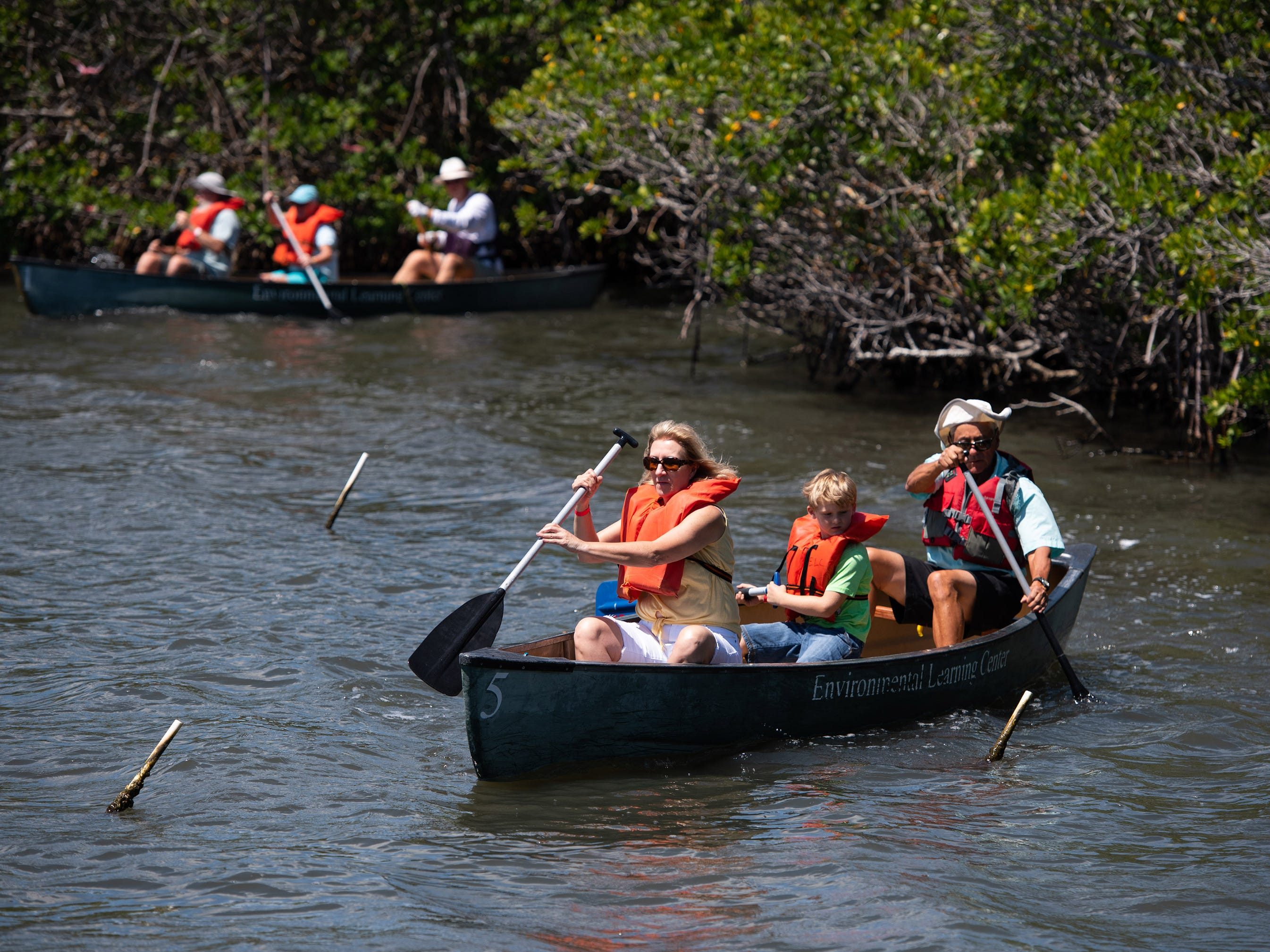"""Cathy Conn (left) and her grandchild Syler Jaques (center), 6, both of Sebastian, tour the mangroves along the Indian River Lagoon by canoe with volunteer guide Mike Murphy (right) during the Environmental Learning Center's first Citizen Science Day on Saturday, April 13, 2019, at The Environmental Learning Center in Wabasso. """"It was awesome,"""" Conn said of the canoe tour. """"Everyone should do it, it was just amazing."""""""