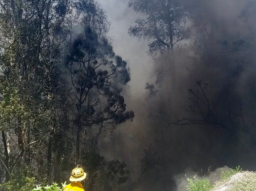 Firefighters in north St. Lucie County contained a wildfire that threatened several homes Saturday