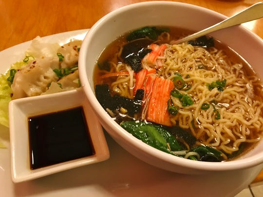 The ramen noodle soup was a  huge bowl of egg noodles with hearty, dark, rich, flavorful broth, pieces of seaweed, spinach, kami, and bean sprouts.