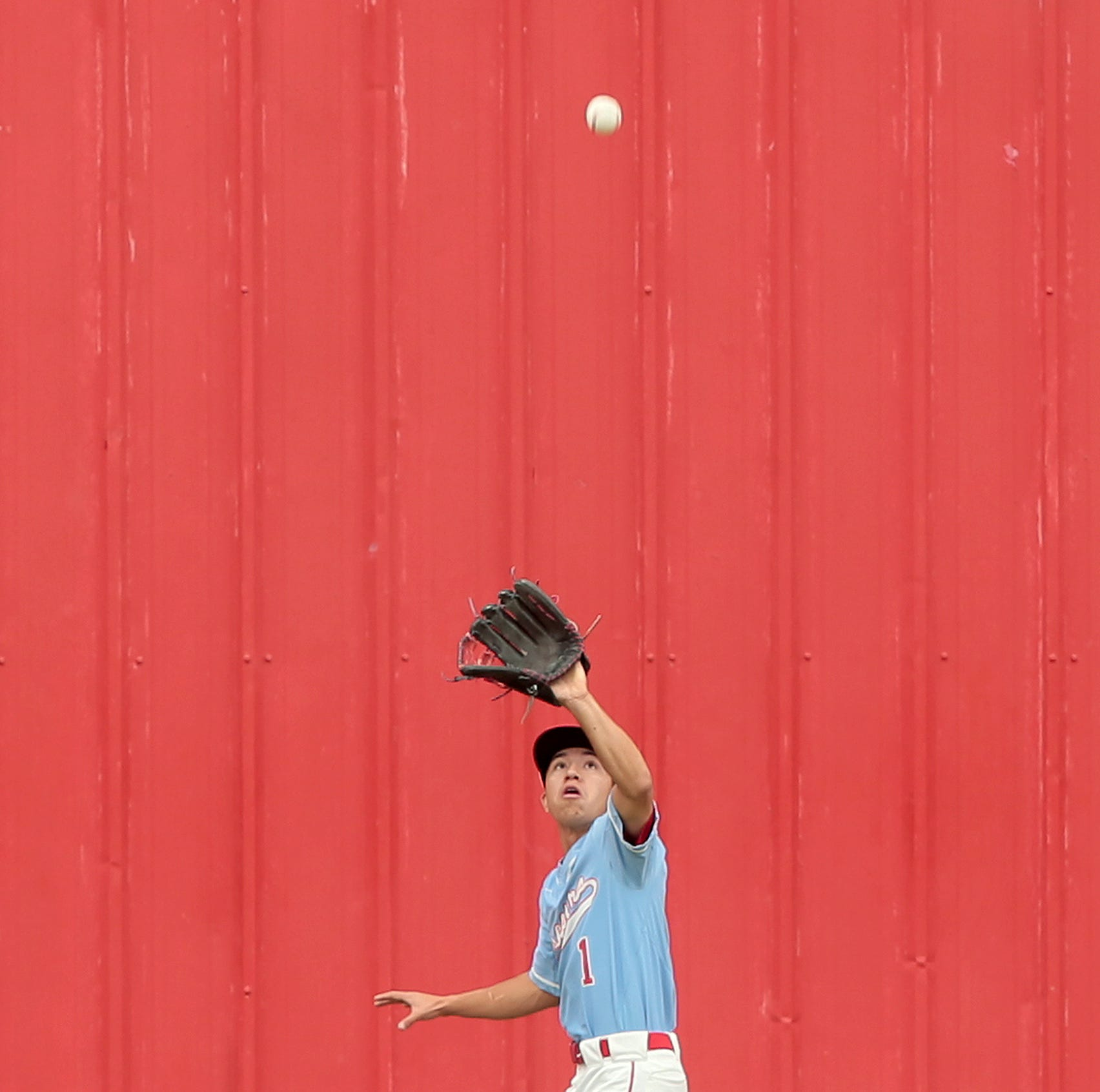 Socorro center fielder Chris Arras makes a play on a deep ball at the warning track during the Bulldogs' game Friday against Franklin.