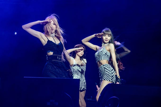 Rose, from left, Jenni Kim, and Lisa of BLACKPINK perform at the Coachella Music & Arts Festival at the Empire Polo Club on Friday, April 12, 2019, in Indio, Calif.