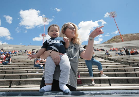 Tierra Fletcher points out daddy to Kalaii Griffin III during UTEP's last spring practice on Saturday at Sun Bowl Stadium. Kalaii's father, Kalaii Griffin, plays linebacker for the Miners.