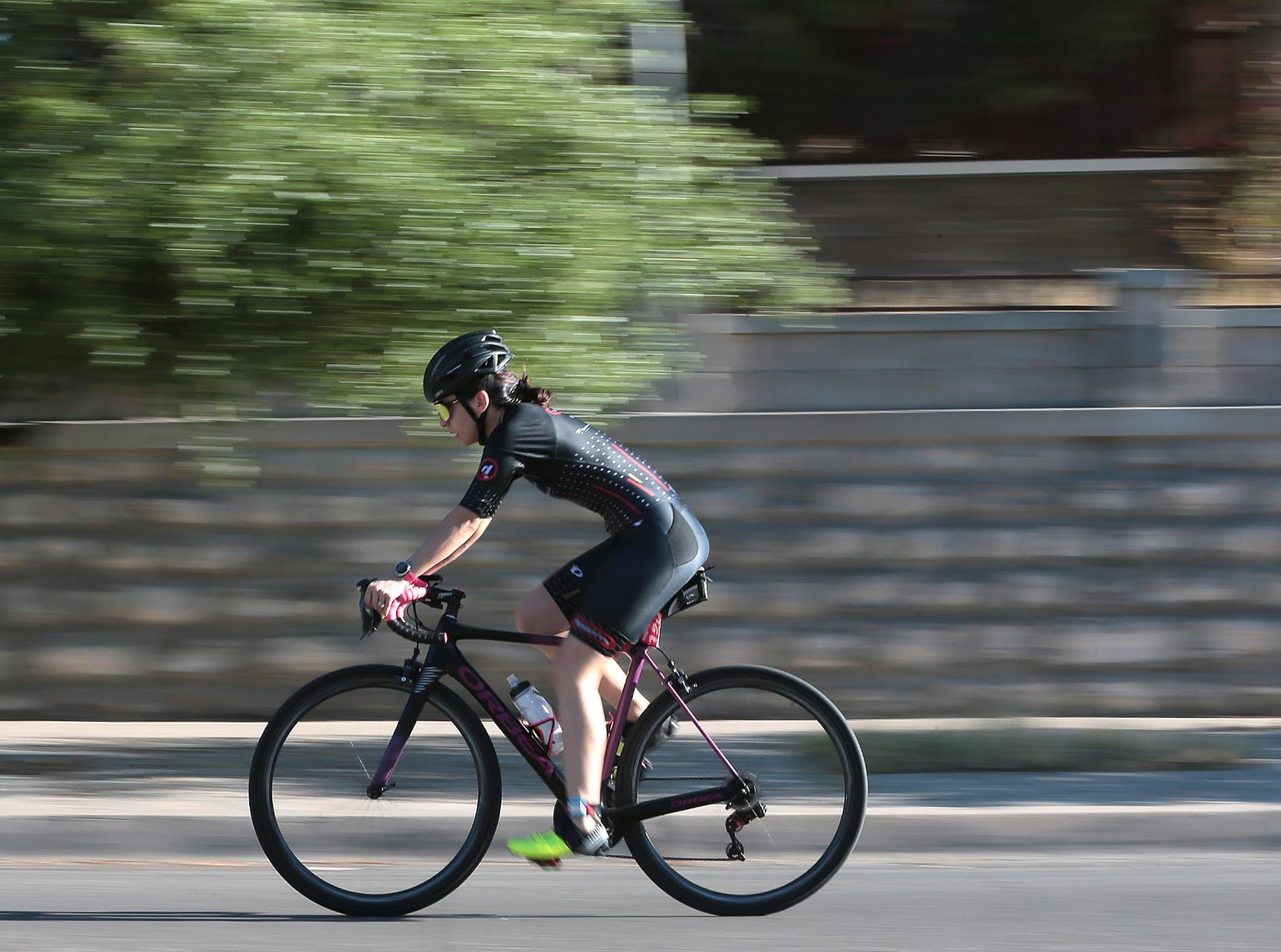A triathlete takes off on the bike portion of the Mighty Mujer Triatlon Saturday at Memorial Park. Over 400 women took part in this year's race.
