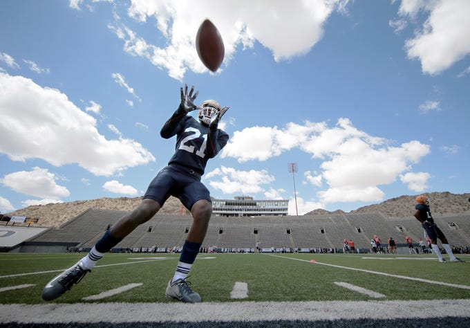 UTEP wide receiver Eddie Sinegal works on a hands drill during UTEP's final spring practice Saturday, April 13, 2019, at Sun Bowl Stadium.