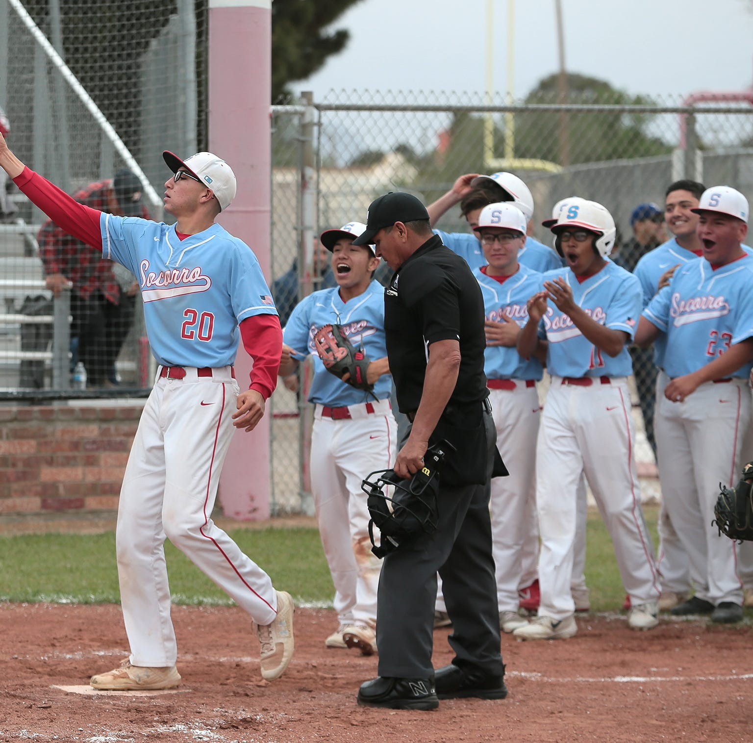 Socorro's Jonathon Rios celebrates his three-run homer to put the Bulldogs ahead 5-3 in the bottom of the third inning Friday against Franklin.