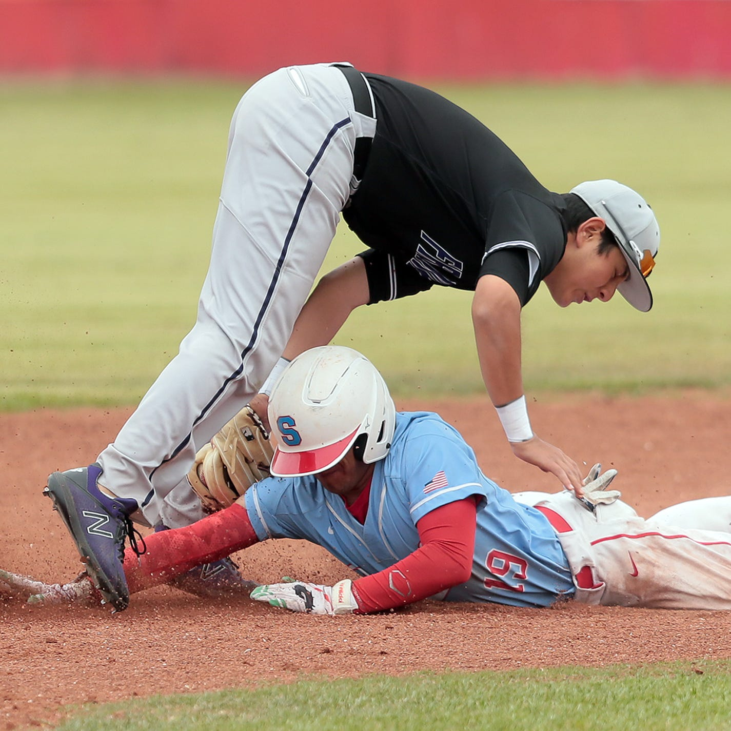 Socorro's Gerardo Contreras collides with Franklin second baseman Eddie Rodriguez as he slides into second during their game Friday afternoon at Socorro High School.
