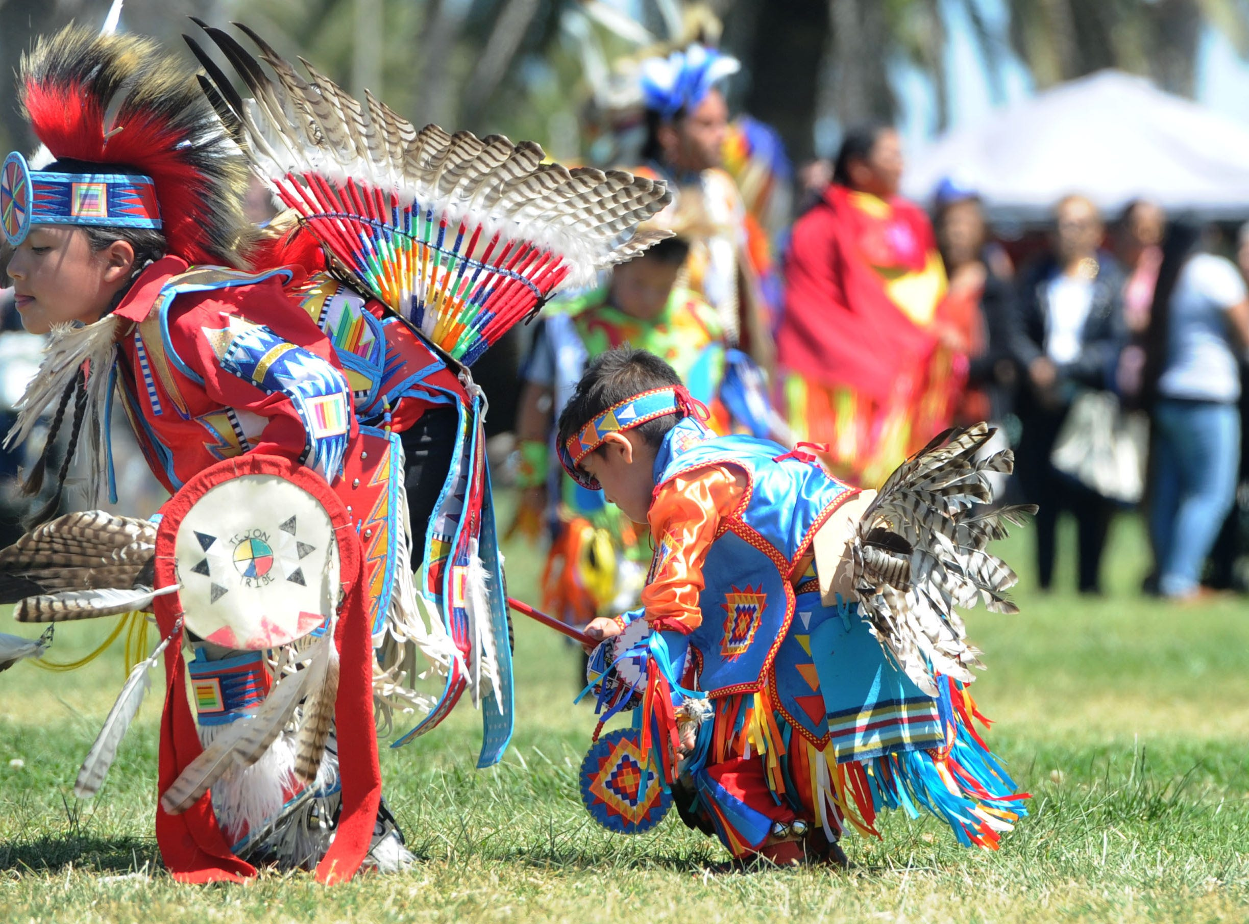 Kenny Gonzales, left, and his brother Steven Gonzales, of Bakersfield, dance during the opening day of the intertribal powwow at Oxnard Beach Park.