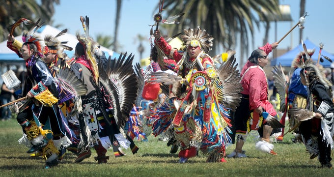 """Native Americans dance Saturday during the grand entrance at the intertribal powwow at Oxnard Beach Park. The theme was """"Honoring Our Elders and Veterans."""""""