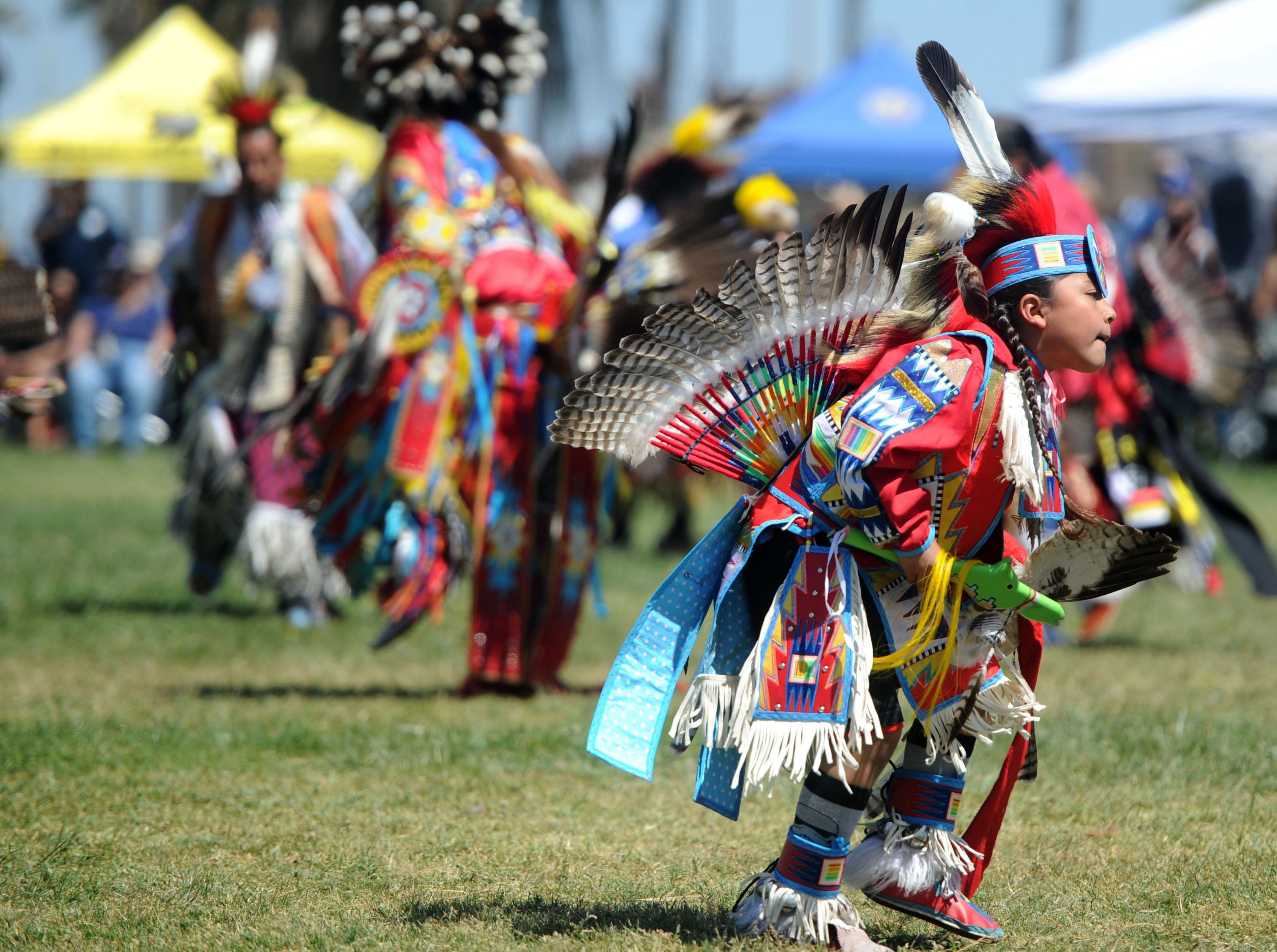 Kenny Gonzales, of Bakersfield, dances during the intertribal powwow at Oxnard Beach Park.