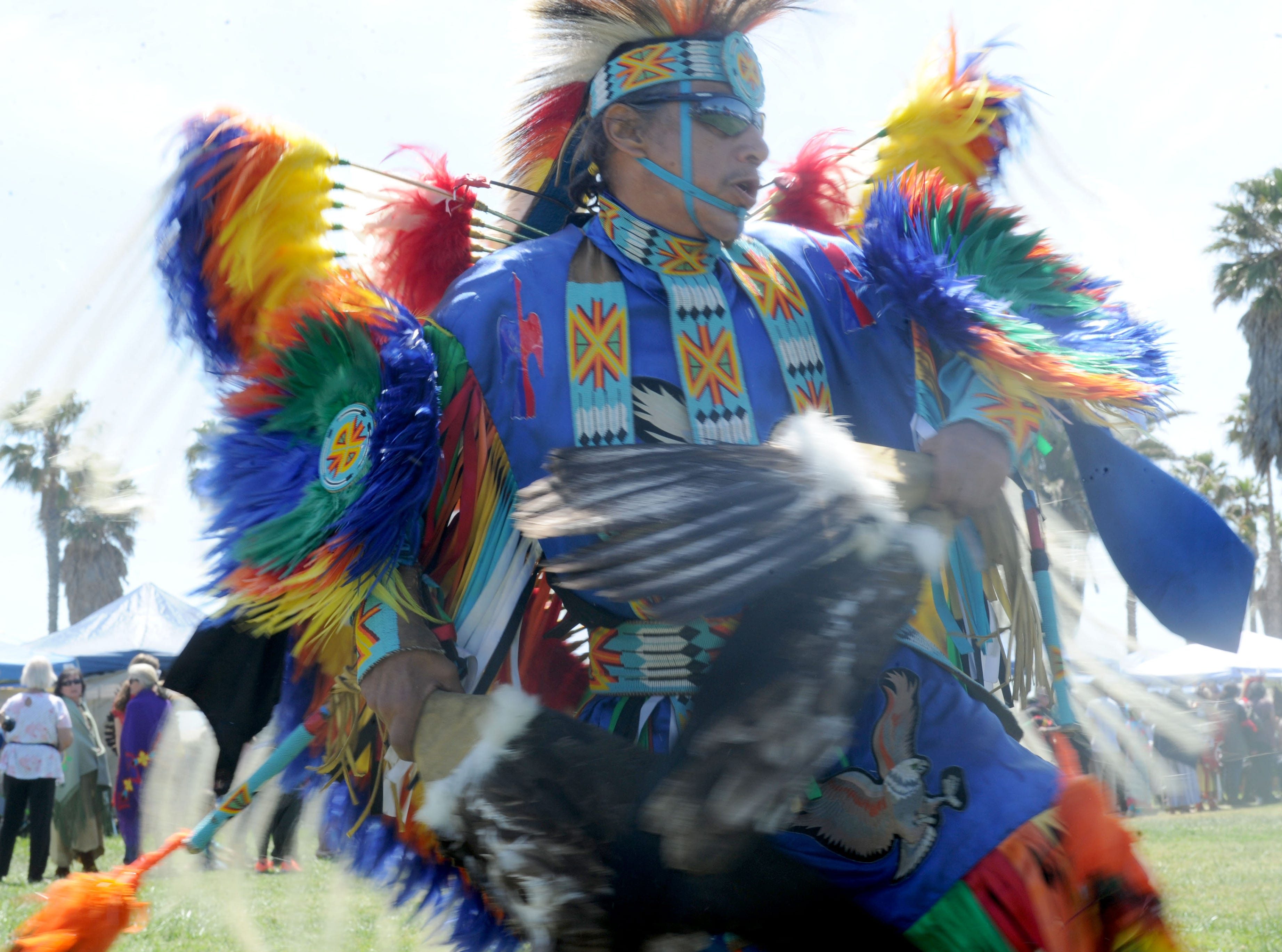 """Michael Paul (Littlevoice) with the Ponca & Omaha Tribe dances Saturday during the intertribal powwow at Oxnard Beach Park. The theme was """"Honoring Our Elders and Veterans."""""""