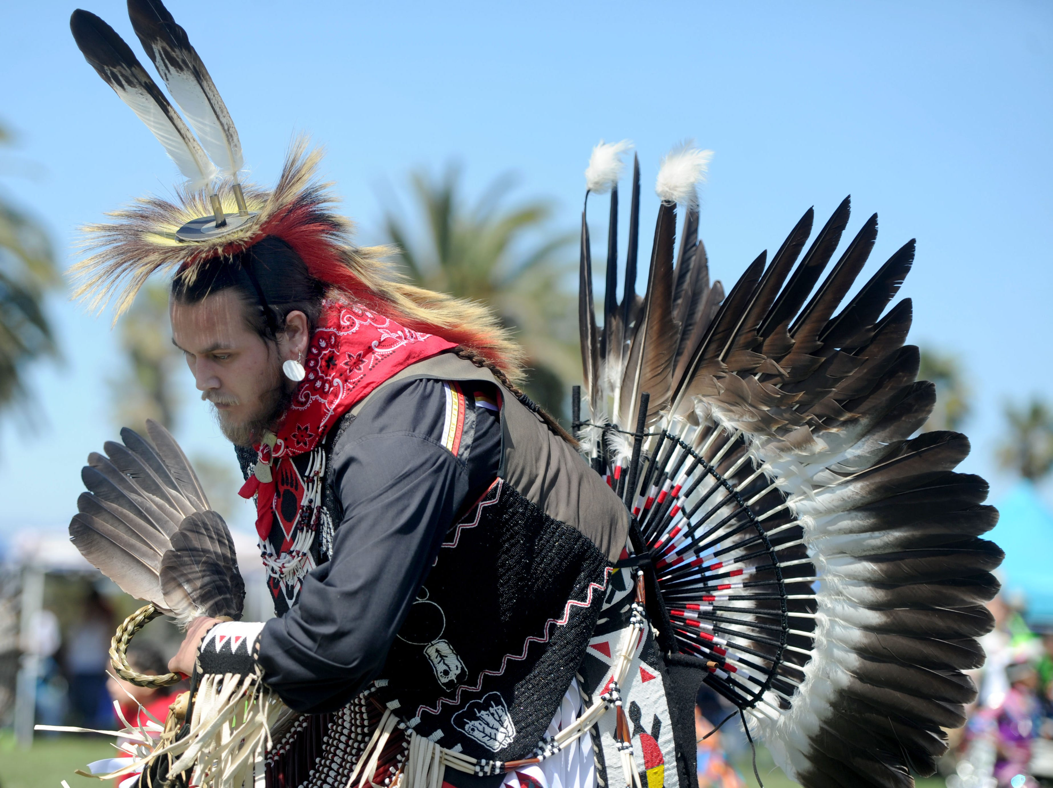 """Kale Flores, of Temecula, dances Saturday during the intertribal powwow at Oxnard Beach Park. The theme was """"Honoring Our Elders and Veterans."""""""