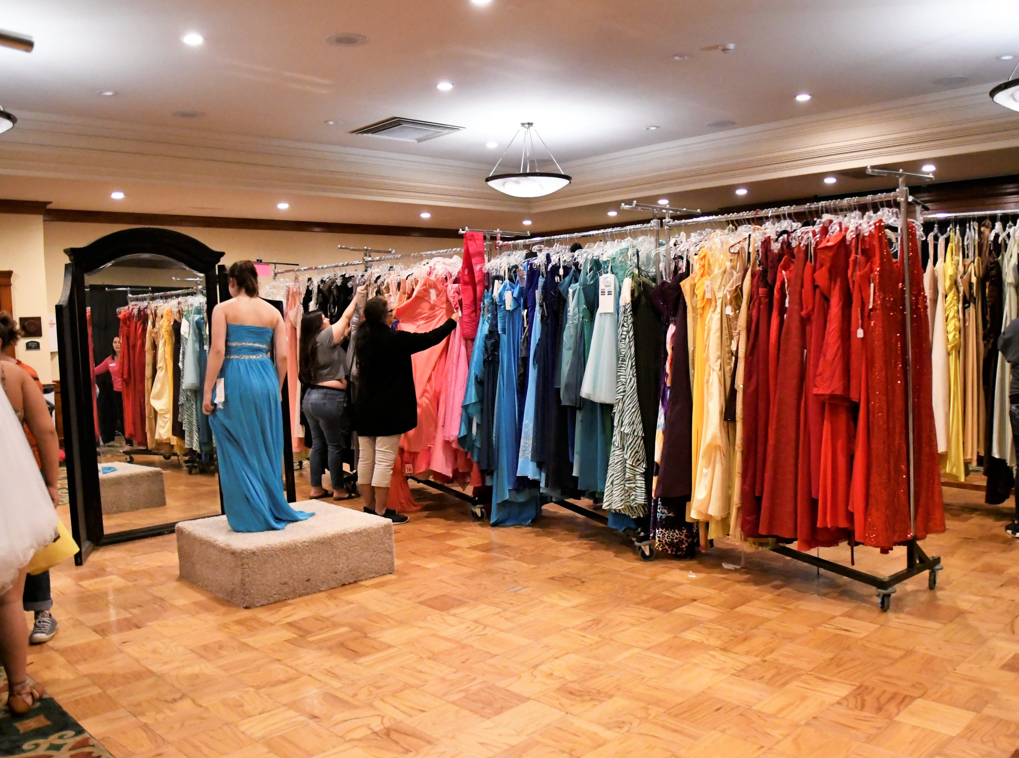 More than 300 junior and senior high school girls signed up to shop for a free prom dress on Saturday, April 13, 2019. The prom dress event is put on by local nonprofit Enchanted Evening. The organization offers free, gently-used prom dresses and accessories to Tulare County girls.