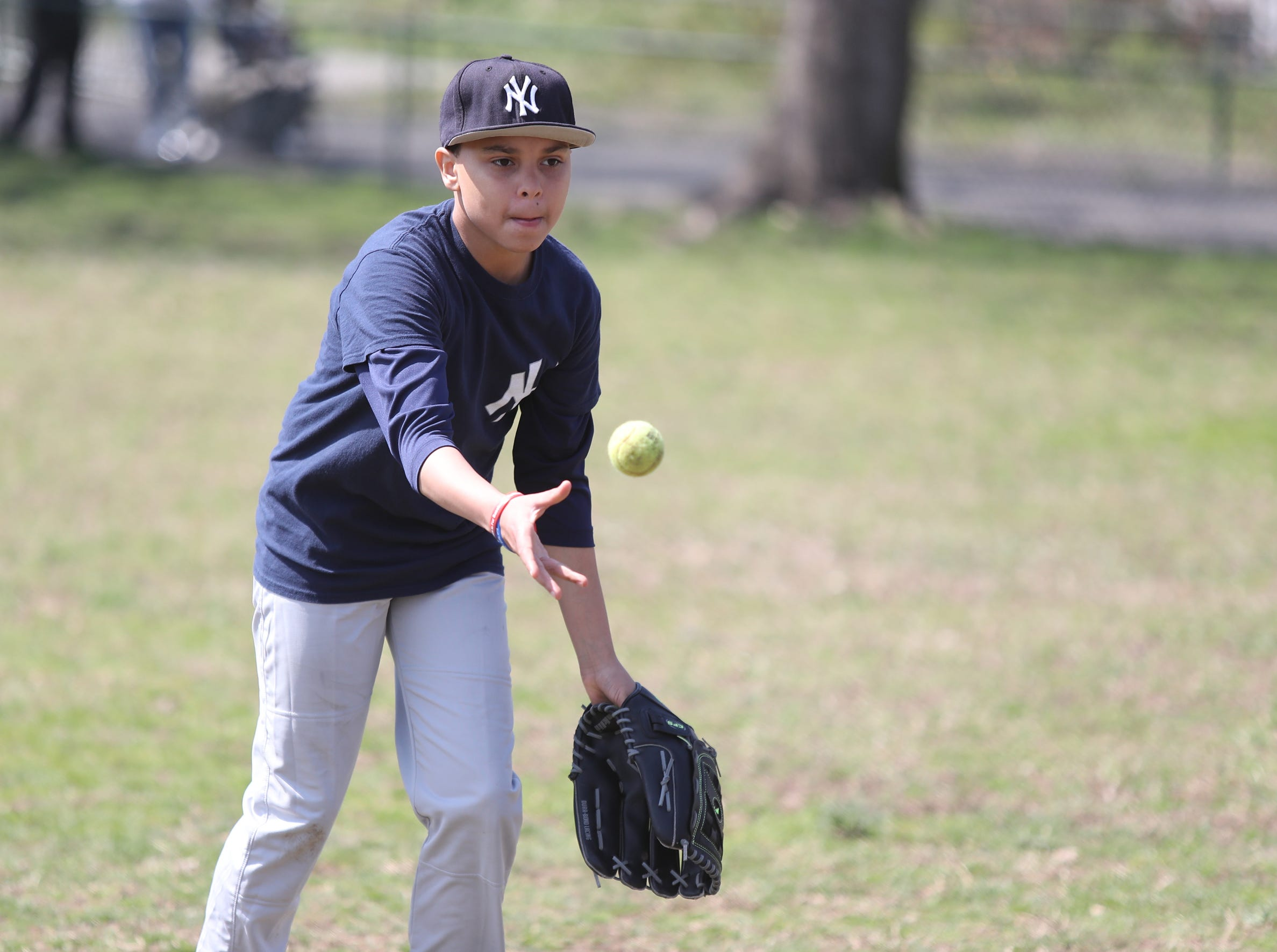 Ronald Lantigua, 11, throws to first during little league practice at Brush Park on Saturday, April 13, 2019 during Jackie Robinson Day in Mount Vernon.