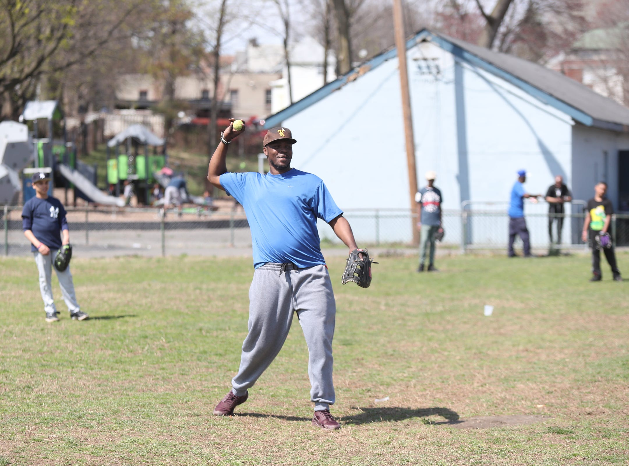 Coach Lawrence Taylor delivers a pitch during little league practice at Brush Park on Saturday, April 13, 2019 during Jackie Robinson Day in Mount Vernon.