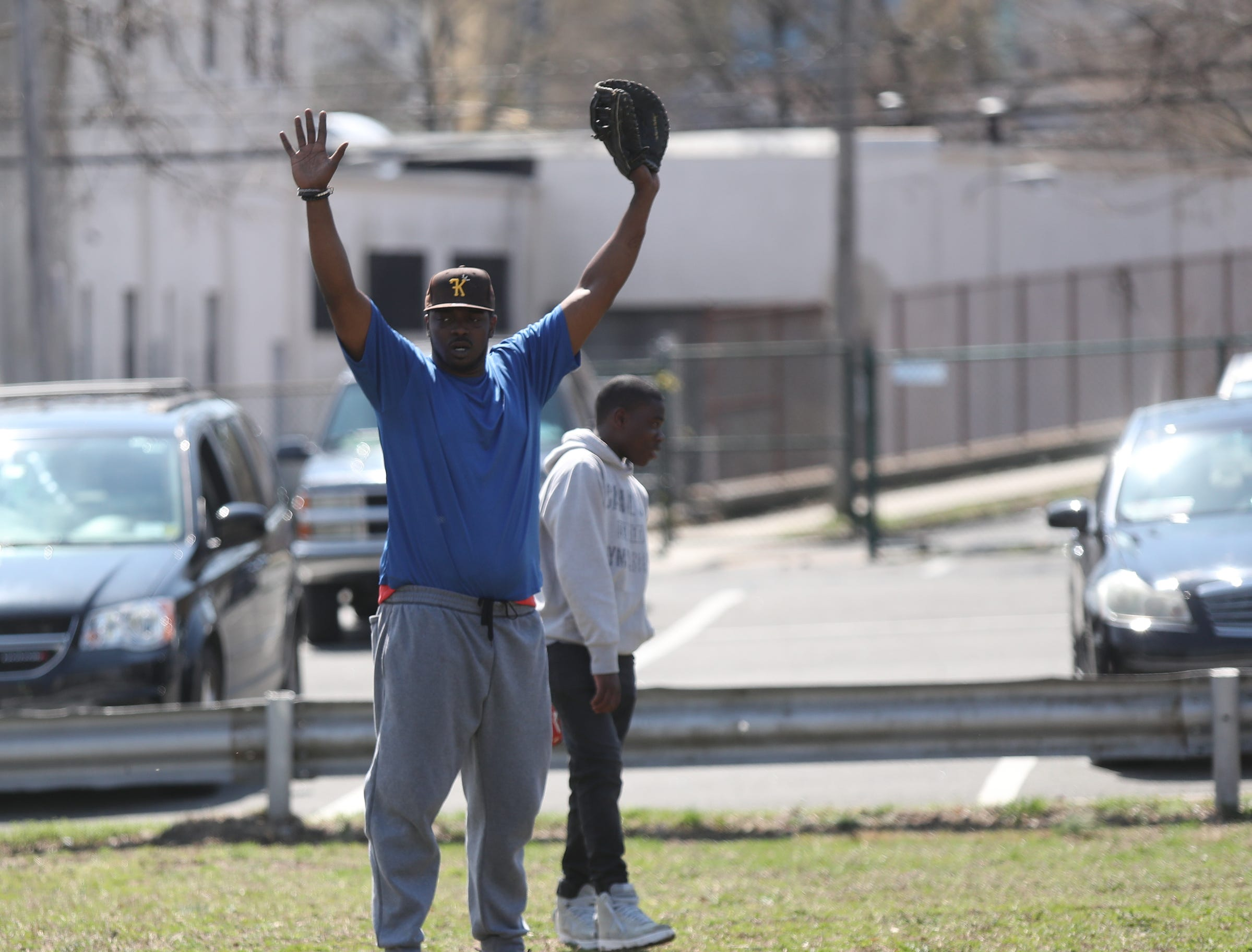 Coach Lawrence Taylor calls time out on the field during little league practice at Brush Park on Saturday, April 13, 2019 during Jackie Robinson Day in Mount Vernon.