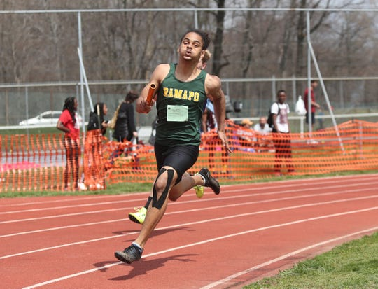 Ramapo's Nathanial Gaines runs in the 4x200-meter relay during the Nanuet Relays at Nanuet High School on Saturday, April 13, 2019.