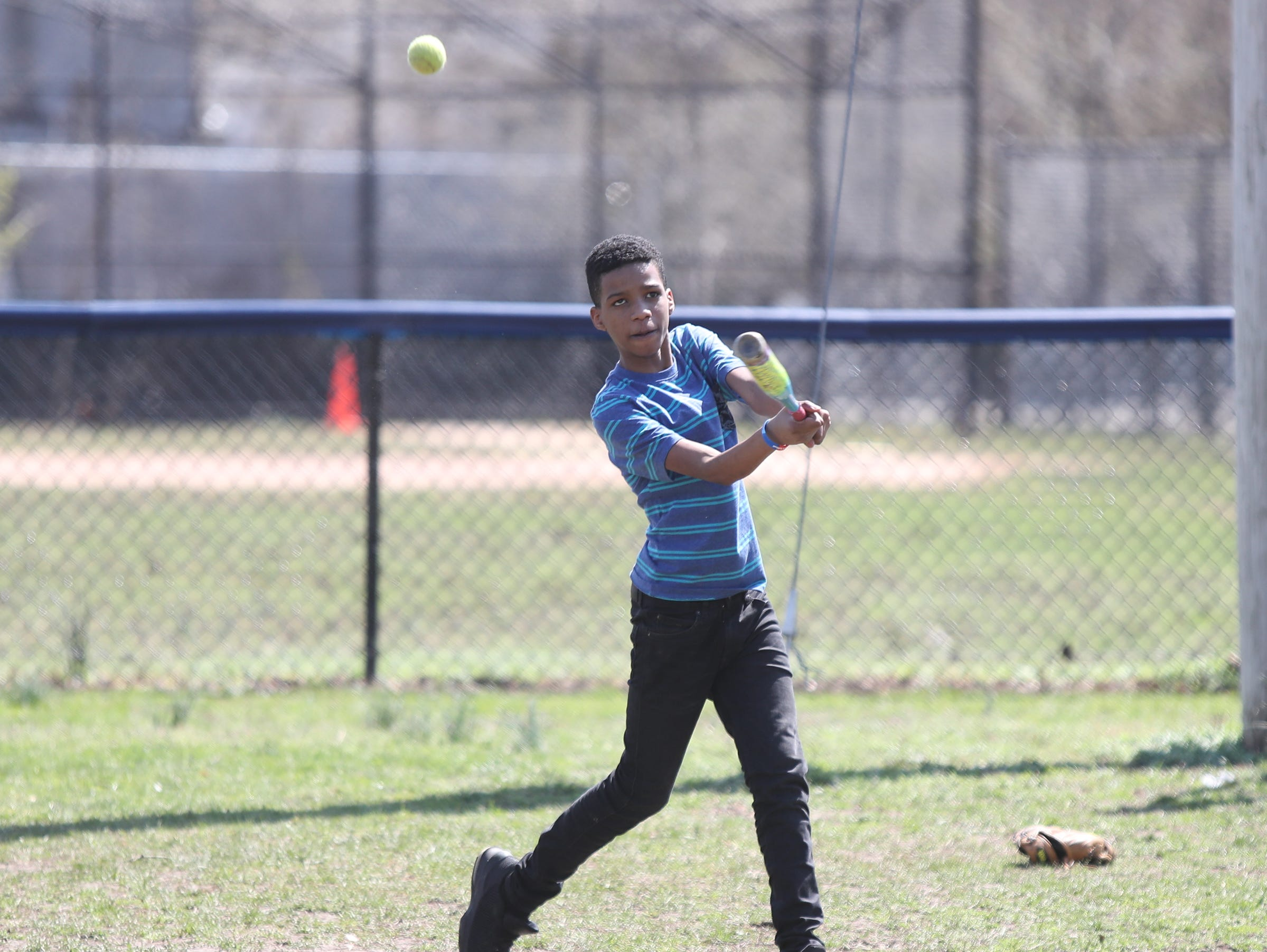 Brian Garcia-Abreu, 11, fouls off a pitch during little league practice at Brush Park on Saturday, April 13, 2019 during Jackie Robinson Day in Mount Vernon.