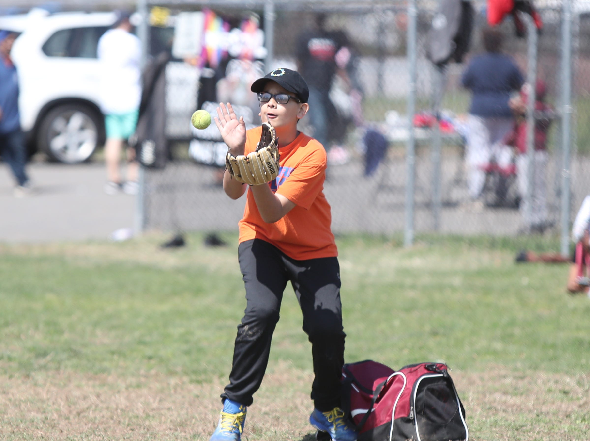 Christian Bueno, 12, pulls in a throw at first base during little league practice at Brush Park on Saturday, April 13, 2019 during Jackie Robinson Day in Mount Vernon.