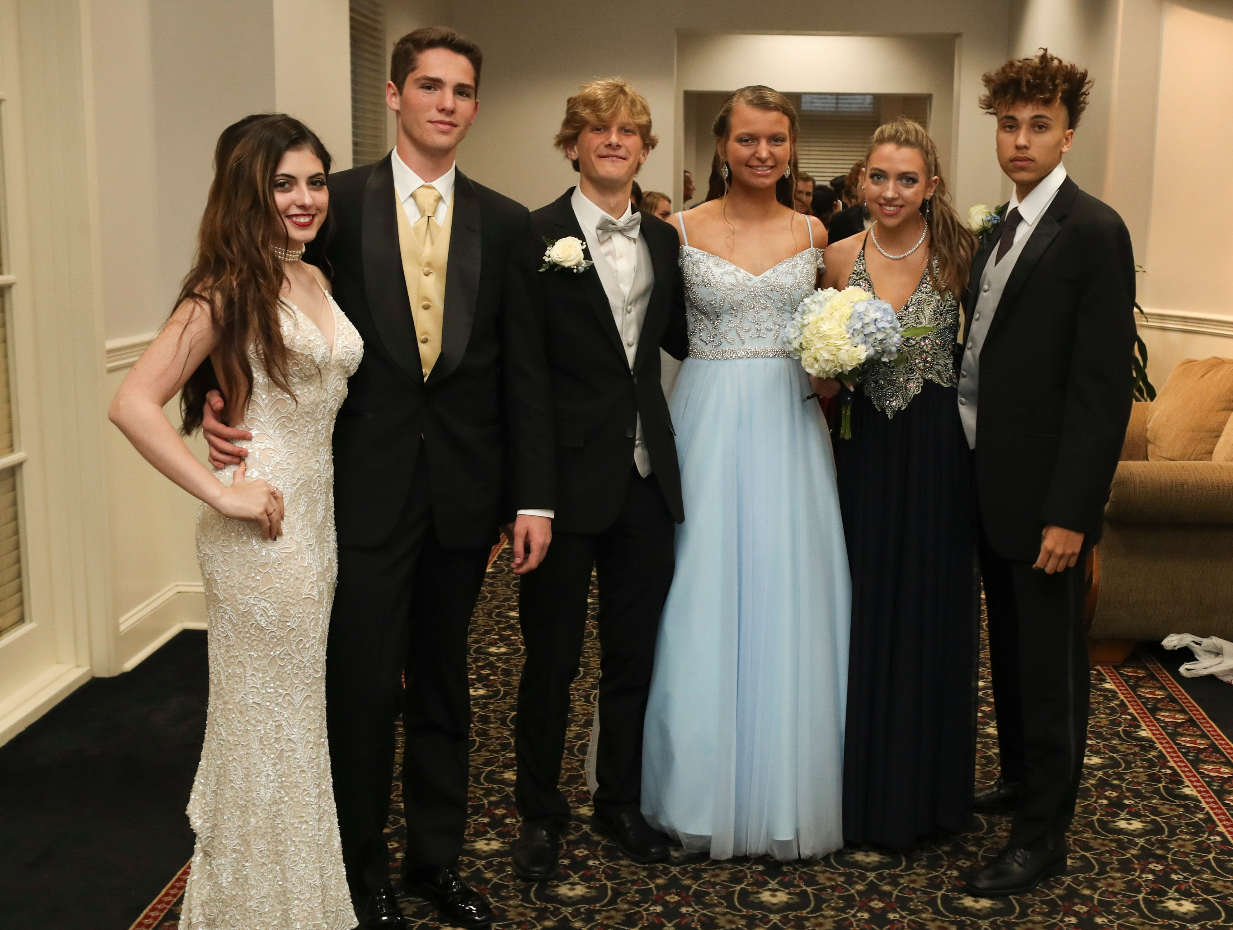 Students and guests arrive at Deerfield Golf Club for the Newark Charter School prom Friday, April 12, 2019.