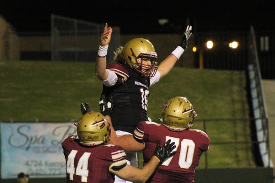 Triston Williams is lifted into the air by his teammates after scoring a touchdown for the Maroon team Friday, April 12, 2019, at the Midwestern State University Spring Game.