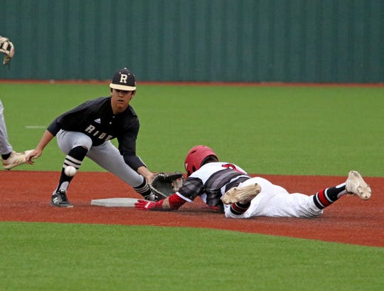 Wichita Falls High School's Jerryd Weaver beats the throw to second against Rider Friday, April 12, 2019, at Hoskins Field.