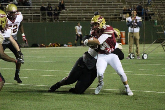 Aquan Randolph tackles Justin Jones as he tries to run the ball during the Midwestern State University Spring Game held at Memorial Stadium Friday, April 12, 2019.