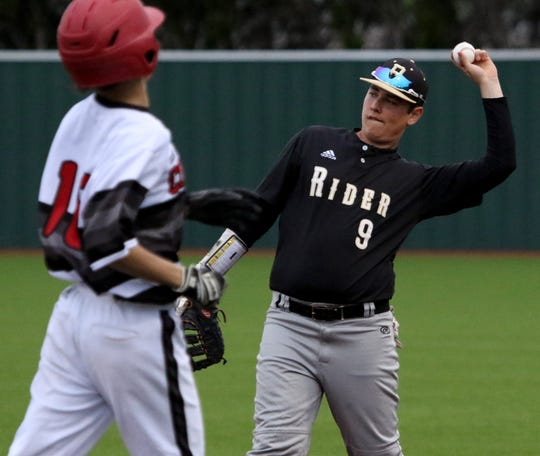 Rider's Ryan Taylor throws back to the pitcher after catching the popup against Wichita Falls High School Friday, April 12, 2019, at Hoskins Field.