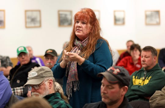 In this Feb. 15, 2019 photo, Cindy Blanc speaks against a the proposed Sugar River Wind Project in the town of Jefferson, Wisc., at a Feb. 28, 2019, town board meeting. Blanc, a town of Jefferson resident, would be able to see turbines from her property. Blanc has worked to organize her neighbors to rally against the turbines. After speaking, Blanc was met with a round of applause from a majority of the more than 70 attendees.