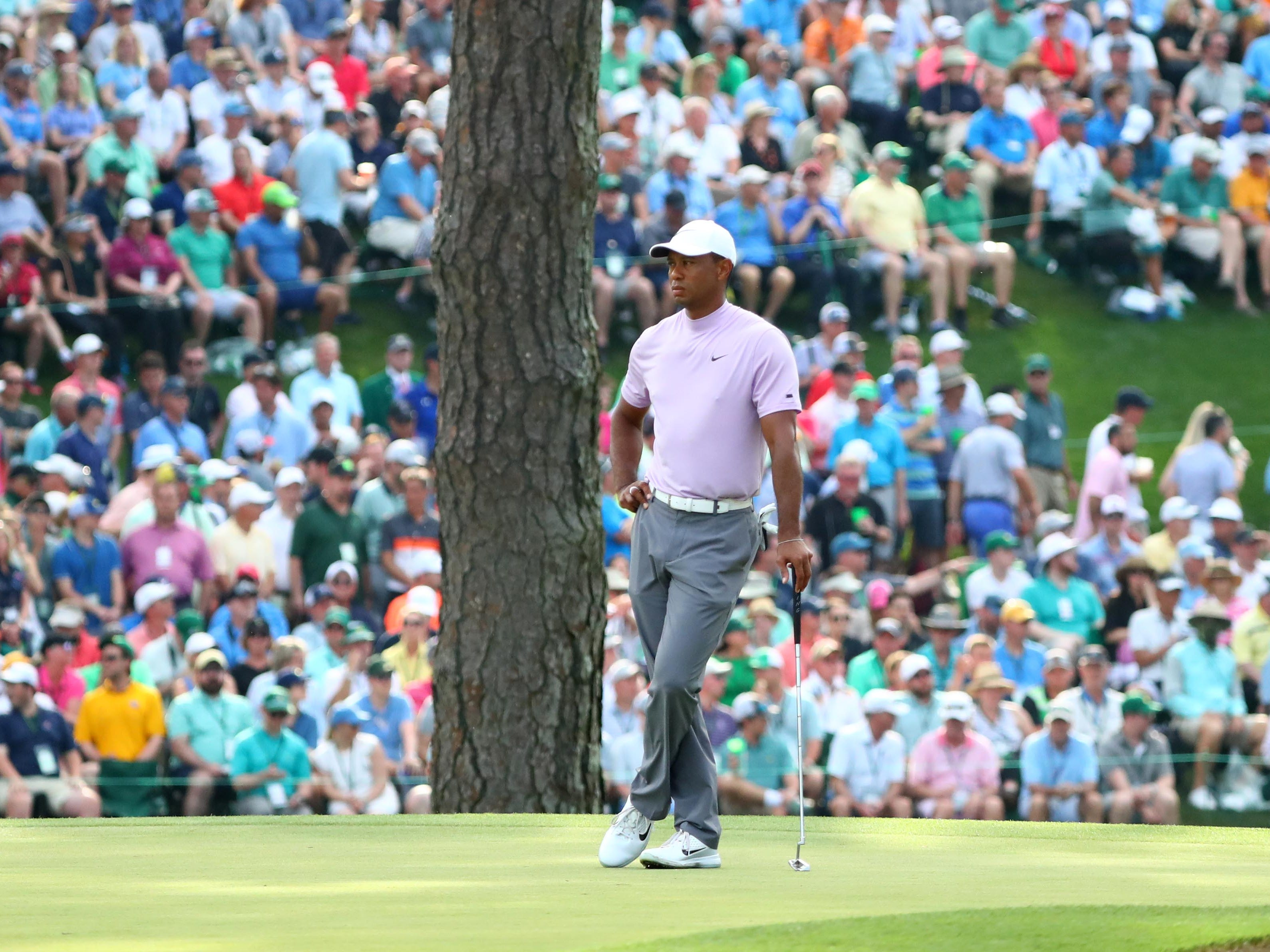 Tiger Woods waits to putt on the 15th green during the third round.