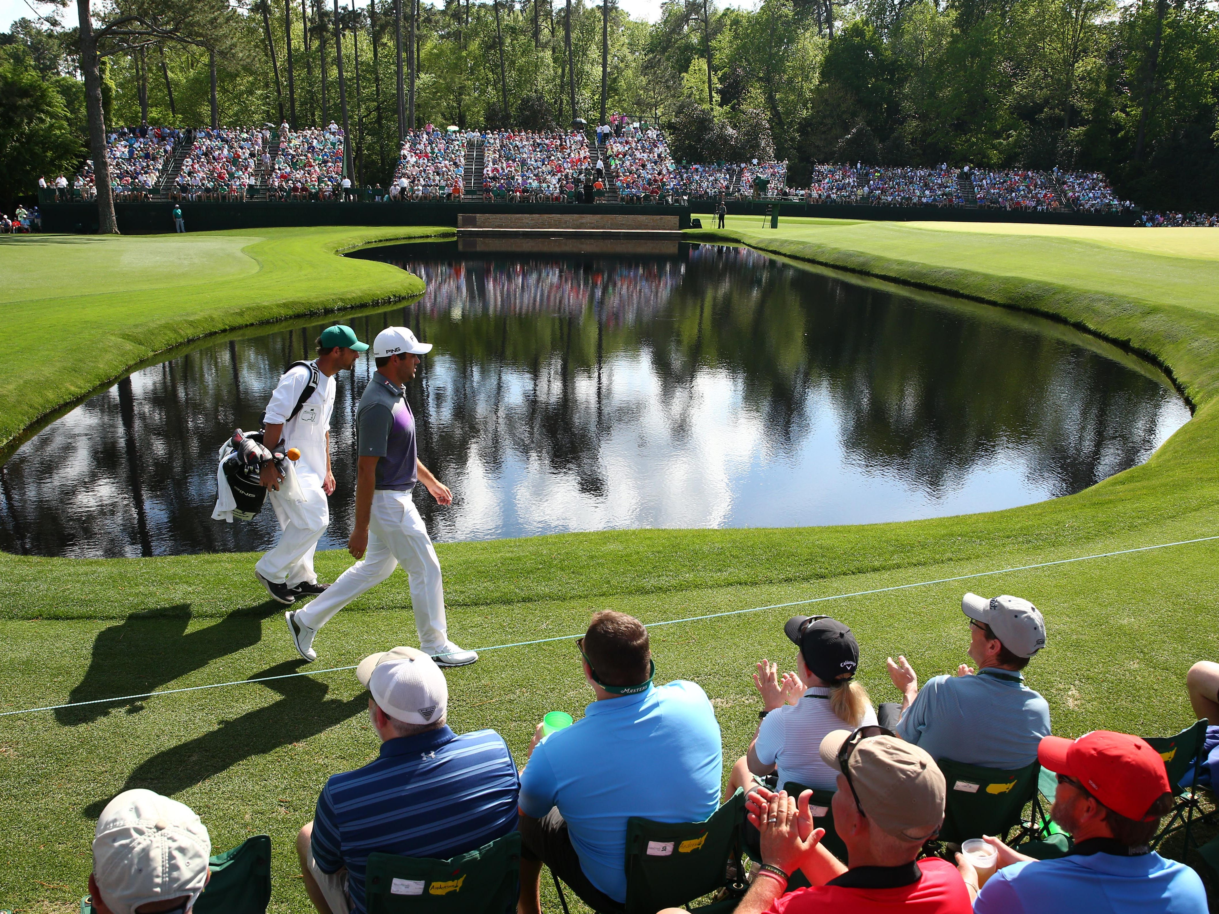 Corey Conners walks to the 15th green during the third round of the Masters.