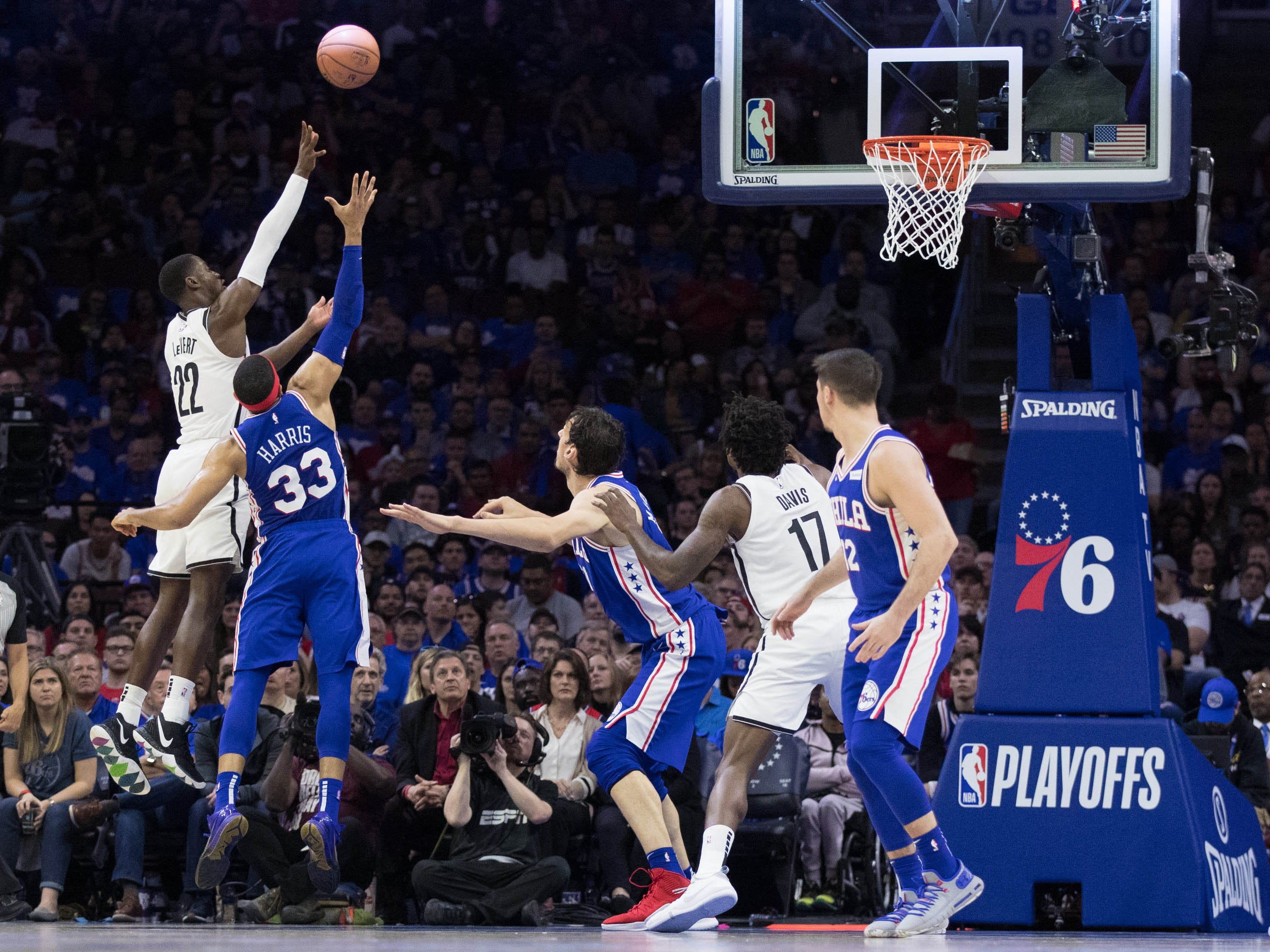 April 13: Nets guard Caris LeVert scores past 76ers forward Tobias Harris during Game 1.
