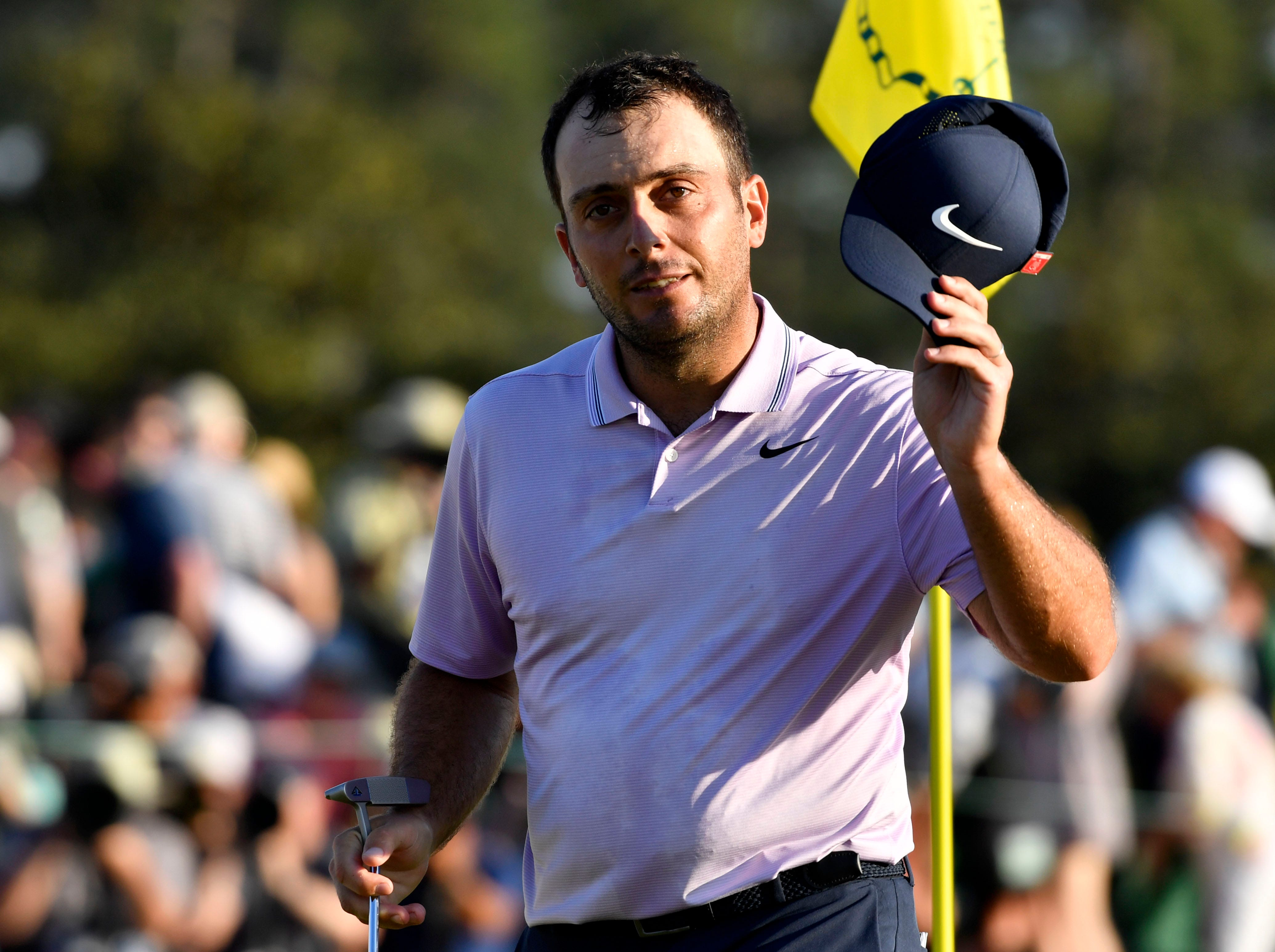 Francesco Molinari waves to the crowd on the 18th green during the third round of the Masters.