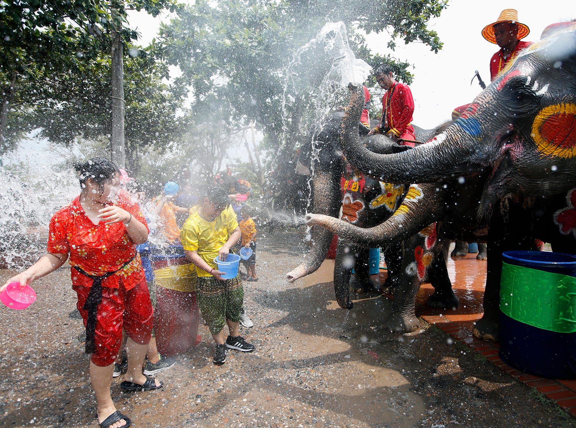 Thai elephant spread water during a preview of the Songkran Festival in the city of Ayutthaya, Thailand on April 11, 2019.