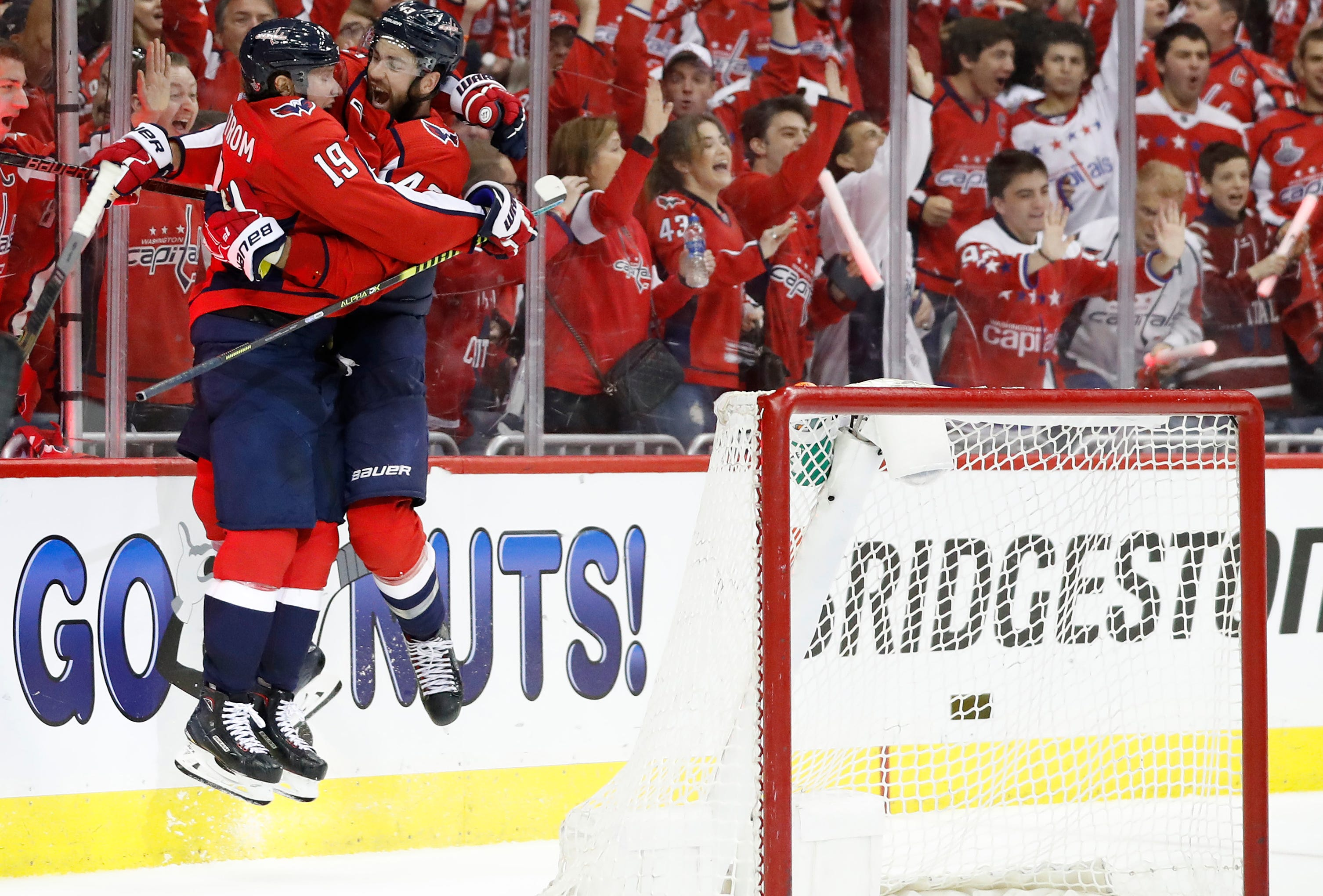 First round: Washington Capitals right wing Tom Wilson and Nicklas Backstrom (19) leap in each other's arms after Wilson's Game 2 goal against the Carolina Hurricanes.