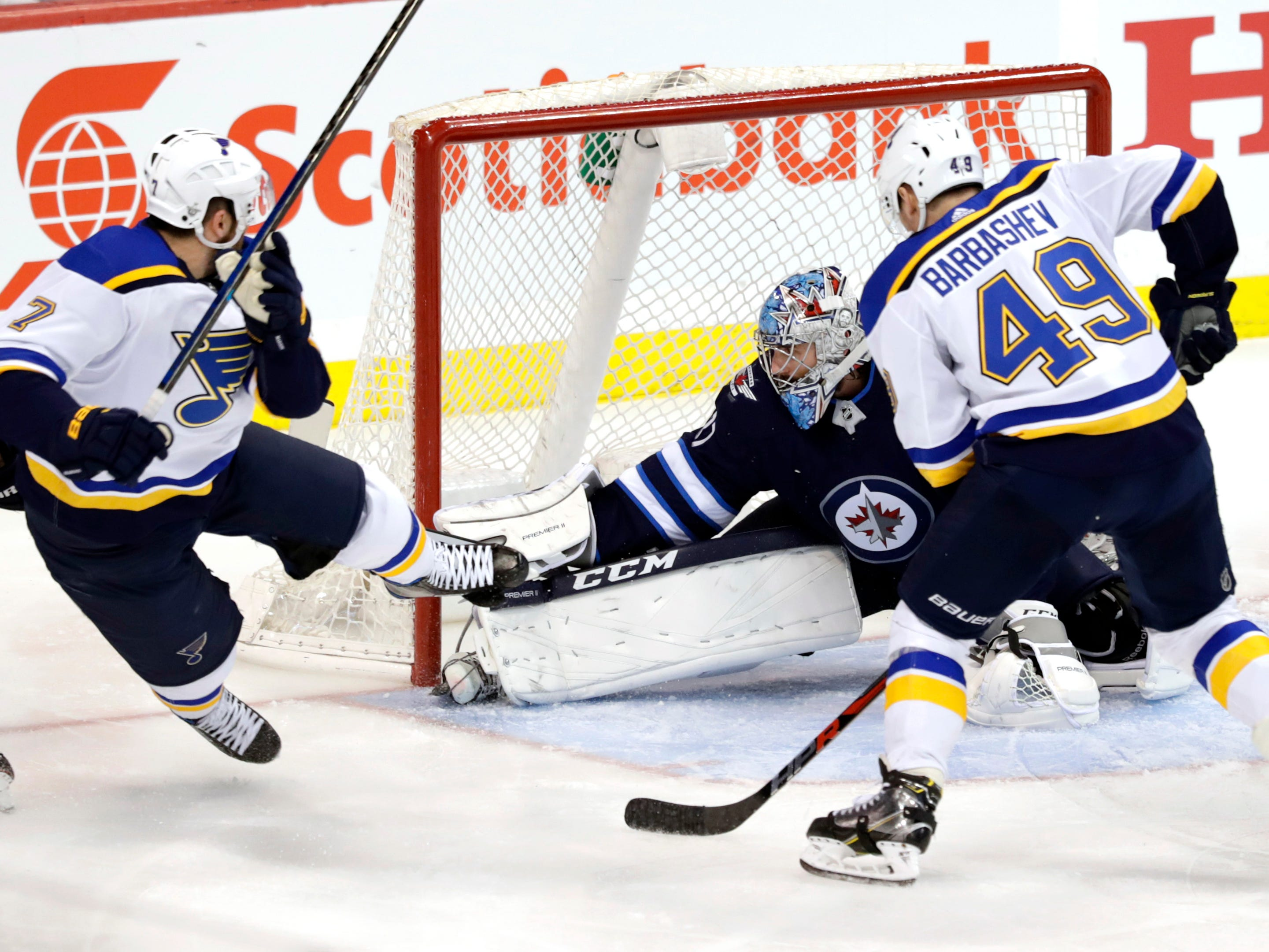 First round: St. Louis Blues left wing Pat Maroon, left, scores on Winnipeg Jets goaltender Connor Hellebuyck in Game 2.