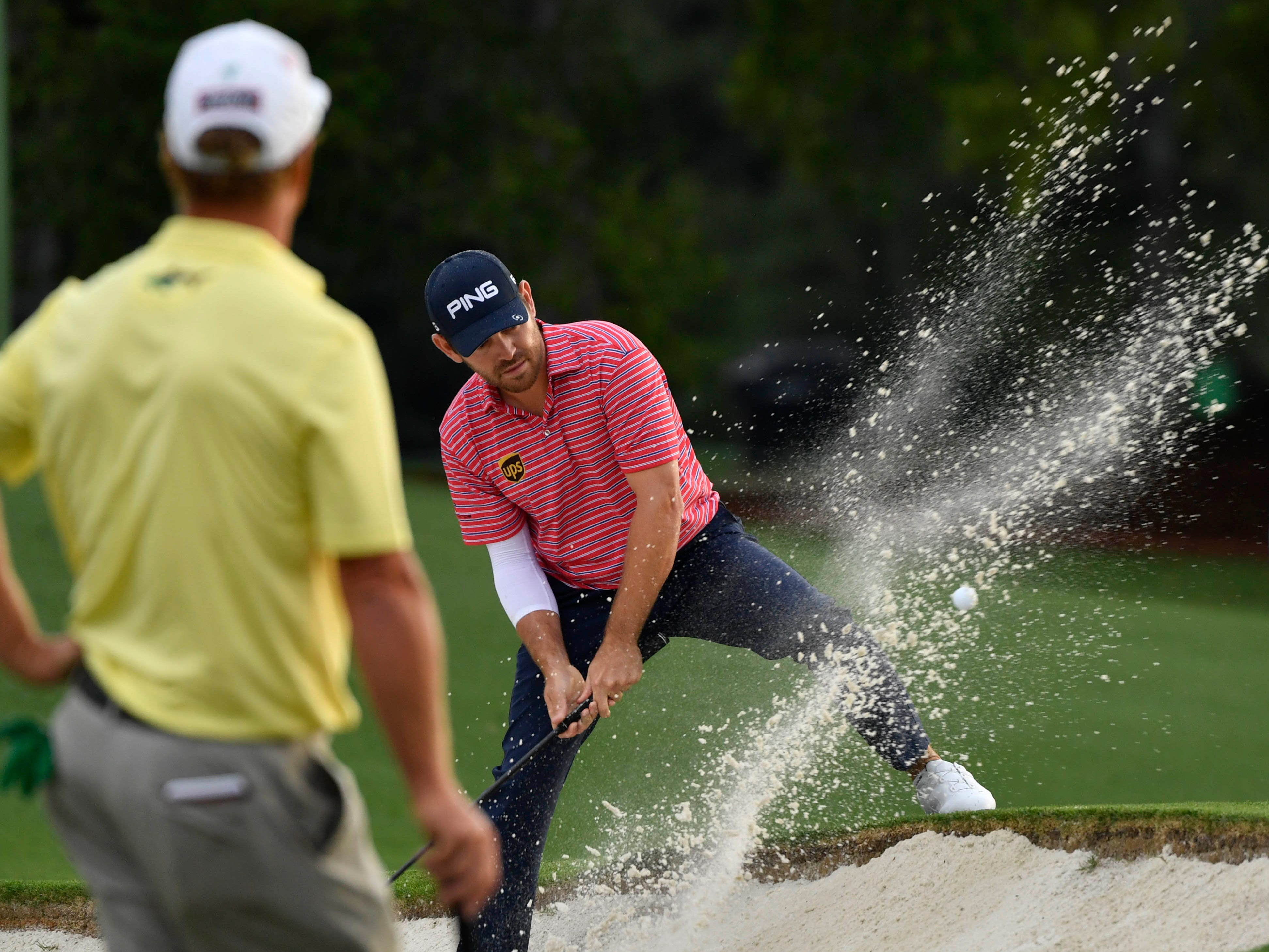 Louis Oosthuizen hits out of a bunker on the 18th hole during the second round.