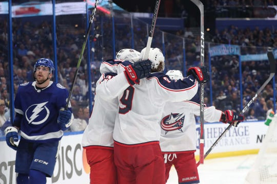 Columbus Blue Jackets center Matt Duchene (95) is congratulated by left wing Artemi Panarin (9) and teammates as he scores a goal against the Tampa Bay Lightning.