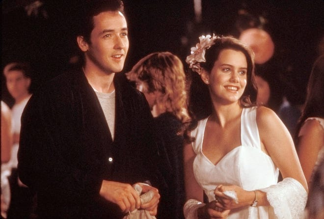 """LloydDobler (John Cusack) and Diane Court (Ione Skye) hit a high school party in the 1989 romantic comedy """"Say Anything."""""""